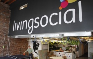 In this April 29, 2011 photo, Ross Arbes, 24, left, plays ping pong while on break at LivingSocial's offices in Washington. (AP Photo/Jacquelyn Martin)